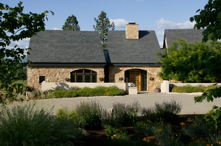 Exterior photo of a nicely done modern custom home.